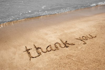Thank you written in sand
