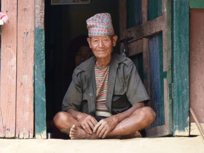 Nepal man sitting in doorway