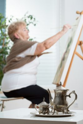 Older Woman Painting