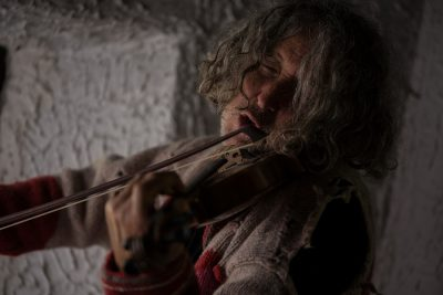 Man With Tousled Long Hair playing violin